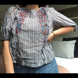 Fun striped blouse with floral details!